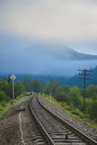 Railroad track and distant mountains seen Stock Photo