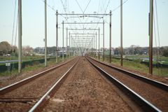 Railroad track until the end of the horizon between Gouda and Rotterdam at Moordrecht. stock photo
