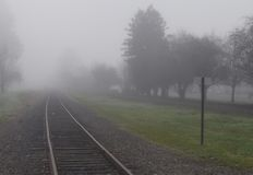 Railroad track in fog. Railroad tracks receding in the fog Stock Photography