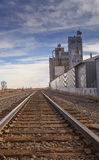 Railroad Track and Grain Elevator. Old railroad tracks along side an abandoned  grain silo on the plains of Colorado Royalty Free Stock Photo