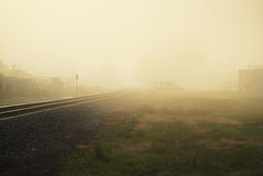 Railroad track on misty morning Royalty Free Stock Images