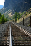 Railroad track in the mountains. Railroad tracks in rural Colorado mountains with curve ahead Stock Photos