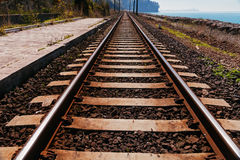 Railroad track near sea beach Stock Photos