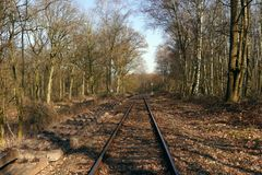 Railroad track, next to new railway sleepers royalty free stock photo