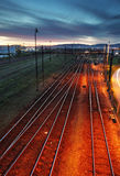 Railroad track at night with colorful sky Royalty Free Stock Images