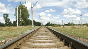 Railroad track in perspective on blue sky Stock Image