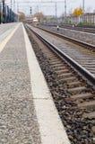 Railroad track, platform and train Royalty Free Stock Photo