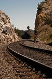 Railroad track between rocks Stock Photo