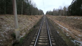 Railroad track running through coutry landscapes stock video