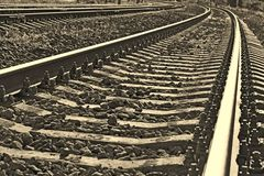 Railroad track into sepia Stock Image