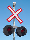 Railroad track x sign crossing intersection road. Road intersection railroad track x sign caution crossing safety Royalty Free Stock Image