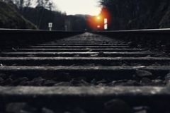 Railroad track with signal lamp in the distance Royalty Free Stock Image