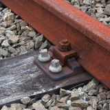 Railroad track on sleeper. Closeup of iron railroad track on sleeper. Nice composition with crossing lines and triangles and warm colors. Square layout stock photos