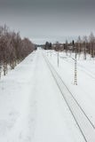 Railroad Track 1. The snowy railroad track leads to the horizon at the rural Finland royalty free stock image