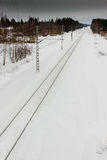 Railroad Track 2. The snowy railroad track leads to the horizon at the rural Finland royalty free stock photo