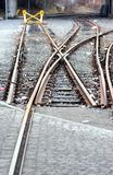 Railroad track stop. Switch and end of railroad tracks, selective focus middle Stock Photos