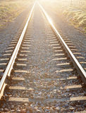 Railroad track sunlit. With a beautiful sunset Royalty Free Stock Images