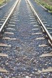 Railroad track sunlit Stock Images