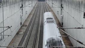 Railroad track. Taxiing aircraft crosses a railroad track, high speed train passing by stock footage