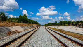 Railroad track. S in bright sky with clouds Stock Images