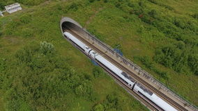 Railroad track and tunnel - aerial view. Passing high-speed train stock video