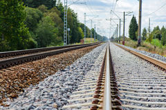 Railroad track vanishing into the distance Stock Photo