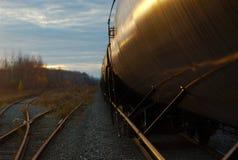 Railroad track and wagon train oil container Stock Image