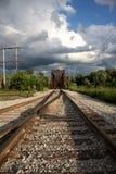 Railroad tracks. Lead you into the photo towards an old steel rail bridge stock image