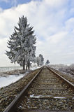 Railroad tracks. Straight railroad tracks vanishing into the winter landscape stock photography