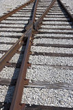 Railroad tracks. Closeup of a railroad crossing switch Royalty Free Stock Photography