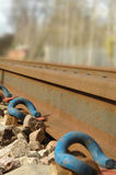 Railroad Tracks. Rusty railroad tracks with blue steel fastenings stock images