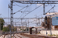 Railroad tracks. Train station with railroad tracks and power lines Stock Photos