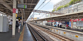 Railroad tracks. TOKYO,JAPAN-JULY 5:Yamanote line at Ueno train station on July 5,2011 in Tokyo,Japan. It is an urban line trian high in some parts of Tokyo´s stock images