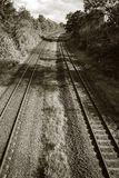 Railroad tracks. Black and white view of empty railroad tracks disappearing around a bend in the distance Stock Photography