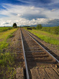 Railroad Tracks. Train tracks stretch into a pretty sky royalty free stock images