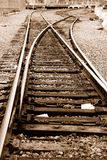 Railroad Tracks. Railroad Train Tracks Switch off to a Loading Dock royalty free stock image