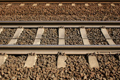 Railroad tracks. Brown Railroad tracks seen from the side Royalty Free Stock Photos