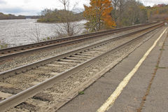 Railroad tracks along the bank of a river. Railroad tracks along the bank of the Mohawk River in rural upstate NY Stock Image