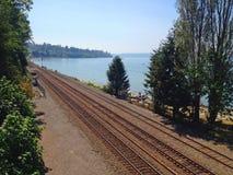 Railroad Tracks Along an Ocean Bay Royalty Free Stock Images