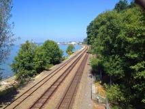 Railroad Tracks Along an Ocean Bay Stock Image