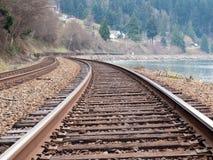 Railroad tracks along the ocean shore stock photography