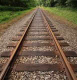 Railroad tracks along the path Royalty Free Stock Images