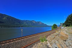 Railroad Tracks along a river Royalty Free Stock Photography