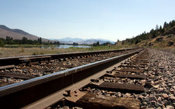 Railroad Tracks along the River Stock Images