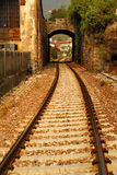 Railroad tracks and archway. Railroad tracks through archway in Italy stock image