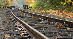 Railroad tracks during Autumn. Railroad tracks leading over a bridge into fall colors stock photography