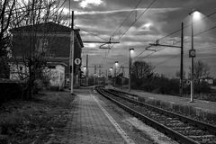 Railroad Tracks by Bare Trees Against Sky Stock Photography