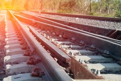 Railroad tracks detail close up. Railroad tracks in beautiful, Orange sunset in low clouds over railroad royalty free stock photography