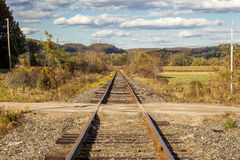 Railroad Tracks Bisect a Dirt Road In Rural Vermont, United Stat Stock Photos