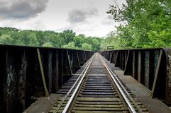Railroad tracks on Bridge. Some railroad tracks crossing a bridge over a river Royalty Free Stock Images